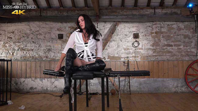 Leather thigh boots mistress Miss Hybrid ripped gusset pantyhose.